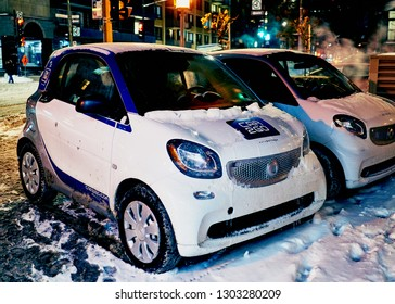 Montreal, Canada - February 2, 2019: German car rental company car2go, a subsidiary of Daimler AG, offers Smart and Mercedes-Benz vehicles and features one-way point-to-point rentals.