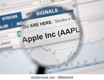 MONTREAL, CANADA - FEBRUARY, 2016 - AAPL - Apple Inc stock ticker with charts under magnifying glass.