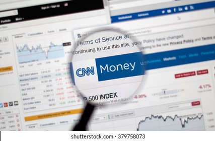 MONTREAL, CANADA - FEBRUARY, 2016 - CNN Money web page under magnifying glass.