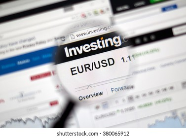MONTREAL, CANADA - FEBRUARY, 2016 - EUR-USD currency pair with charts under magnifying glass.