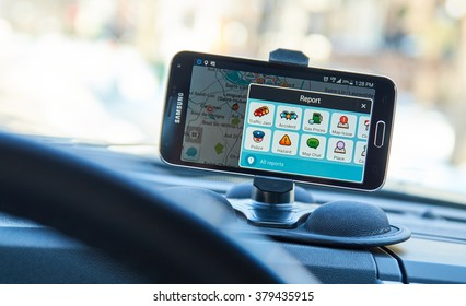 MONTREAL, CANADA - FEBRUARY, 2016 - GPS navigation application Waze running on Samsung S5 in a car.