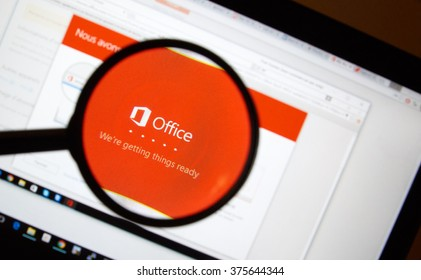 MONTREAL, CANADA - FEBRUARY, 2016 - Microsoft Office 365 installation process on a laptop under magnifying glass.