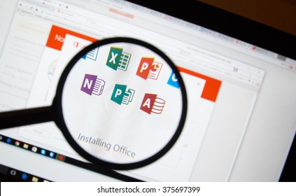 MONTREAL, CANADA - FEBRUARY, 2016 - Microsoft Office 365 software installation on a laptop under magnifying glass.