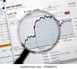 MONTREAL, CANADA - FEBRUARY, 2016 - S&P 500 stock market index's chart on web page under magnifying glass.