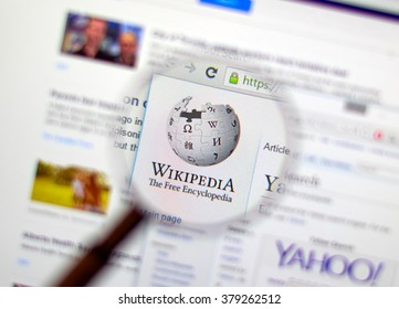 MONTREAL, CANADA - FEBRUARY, 2016: Wikipedia homepage on the computer screen under magnifying glass. Wikipedia is a free Internet encyclopedia.