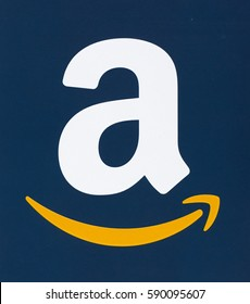 MONTREAL, CANADA - FEBRUARY 28, 2017: Amazon logo printed on a blue paper. Amazon is an American electronic commerce and cloud computing company that was founded on July 5, 1994 by Jeff Bezos.