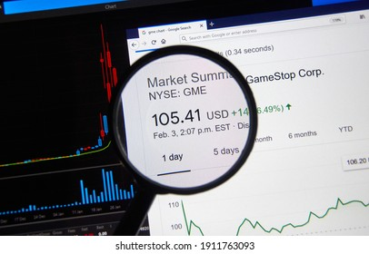 Montreal, Canada - February 3, 2021: GME GameStop price over chart under magnifying loop. Gamestop GameStop Corp. is an American video game, consumer electronics known for Wallstreetbets stock pump.
