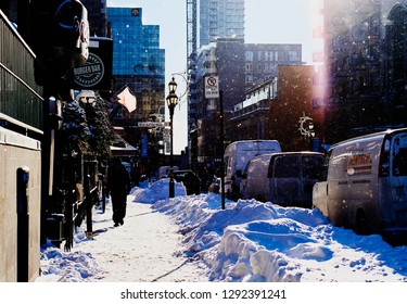 MONTREAL, CANADA - JANUARY 22 2019: Snowy downtown street on a sunny morning.