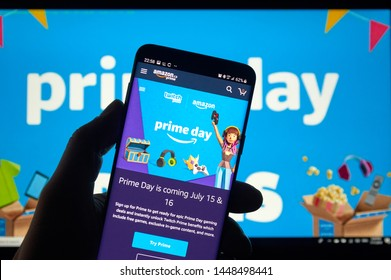 MONTREAL, CANADA - JULY 11, 2019 : Amazon prime day page and twitch logo on phone screen over Amazon home page. Amazon Prime Day is a big members-only summer sale in month of July each year