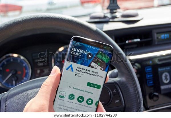 MONTREAL, CANADA - JULY 15, 2018: Google android Auto application on a cell phone. Android Auto is a smart driving companion.