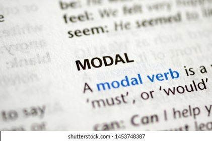 MONTREAL, CANADA - JULY 17, 2019: word modal in a dictionay with meaning. Close-up and selective focus.