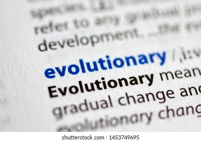MONTREAL, CANADA - JULY 17, 2019: word evolutionary in a dictionay with meaning. Close-up and selective focus.
