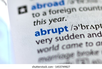 MONTREAL, CANADA - JULY 17, 2019: word abrupt in a dictionay with meaning. Close-up and selective focus.