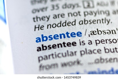 MONTREAL, CANADA - JULY 17, 2019: word absentee in a dictionay with meaning. Close-up and selective focus.