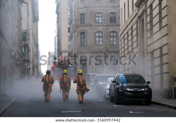 Montreal, Canada - july 18 2019: firefighters entering a dangerous area with smokes after an explosion