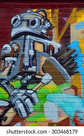MONTREAL CANADA JULY 25 2015: Street art robot. Montreal is the perfect place to walk in the back alleys and abandoned areas, looking for street art.