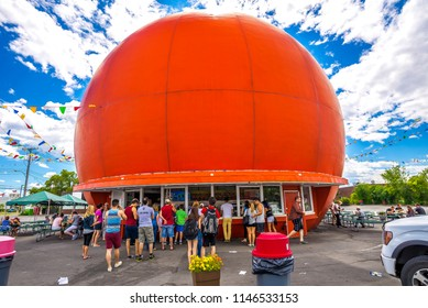 Montreal, Canada - July 3 2016: People lining up at iconic Gibeau Orange Julep on a sunny summer day.
