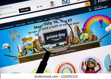 MONTREAL, CANADA - JULY 3, 2018 : Amazon prime day page on official amazon site under magnifying glass. Amazon Prime Day is the retailer's big members-only summer sale in month of July each year.