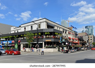MONTREAL, CANADA - JUN 13, 2015: The corner of Crescent Street and De Maisonneuve Boulevard.  Crescent St is a very popular area containing many trendy shops, bars, nightclubs and restaurant.
