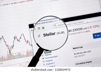 MONTREAL, CANADA - JUNE 20, 2018: Stellar crypto currency price under magnifying glass. Cryptocurrency is a digital currency in which encryption techniques are used to generate and transfer funds.