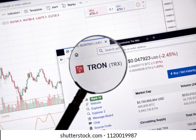 MONTREAL, CANADA - JUNE 20, 2018: Tron crypto currency price under magnifying glass. Cryptocurrency is a digital currency in which encryption techniques are used to generate and transfer funds.