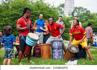 Montreal, Canada - June, 2018. African male and female percussionists play rhythm with djembe and dunun drums at Tam Tams festival in Mount Royal Park, Montreal, Canada. Editorial use.