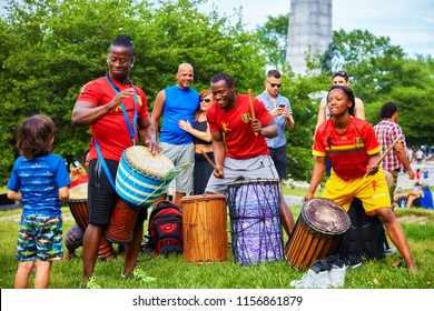 Montreal, Canada - June, 2018. African male and female percussionists play djembe and dunun bongo drums at Tam Tams festival in Mount Royal Park, Montreal, Quebec, Canada. Editorial use.