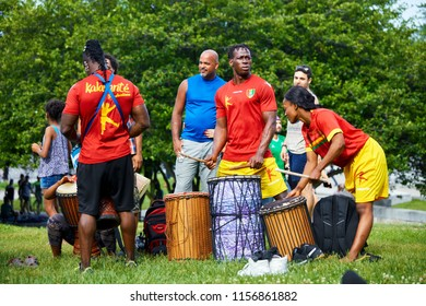 Montreal, Canada - June, 2018. African American male and female percussionists play rhythm with drums at Tam Tams festival in Mount Royal Park, Montreal, Quebec, Canada. Editorial use.