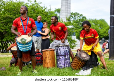 Montreal, Canada - June, 2018. African American male and female percussionists play djembe and dunun drums at Tam Tams festival at Mount Royal Park, Montreal, Quebec, Canada. Editorial use.