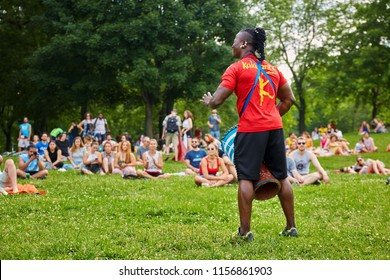 Montreal, Canada - June, 2018. African male percussionist playing his djembe drum bongo in front of the audience at Tam Tams festival in Mount Royal Park, Montreal, Quebec, Canada. Editorial