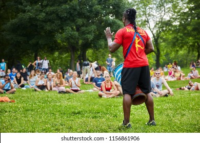 Montreal, Canada - June, 2018. African male percussionist plays bongo in front of the audience at Tam Tams festival in Mount Royal Park, Montreal, Quebec, Canada. Editorial use.