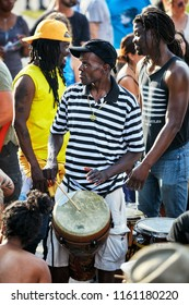 Montreal, Canada - June, 2018. African American male percussionist plays djembe drum bongo at Tam Tams festival at Mount Royal Park, Montreal, Quebec, Canada. Editorial use.