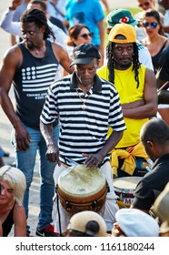 Montreal, Canada - June, 2018. African American male percussionist plays djembe drum bongo at Tam Tams festival in Mount Royal Park, Montreal, Quebec, Canada. Editorial use.