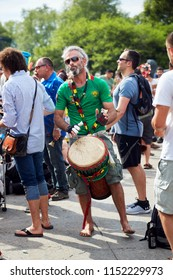 Montreal, Canada - June, 2018. Caucasian male percussionist plays rhythm with djembe drum bongo in the crowd at Tam Tams festival in Mount Royal Park, Montreal, Quebec, Canada. Editorial use.