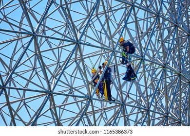 Montreal, Canada, June, 2018. Construction workers doing maintenance job on the steel bars of the biosphere environment museum in Montreal, Quebec, Canada. Editorial use.