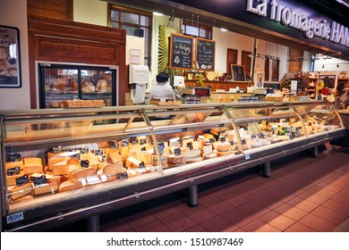 Montreal, Canada, June, 2018: Delicatessen shop with various cheese in the display cabinet and a worker behind the counter at Atwater Market in Montreal, Quebec, Canada. Editorial.
