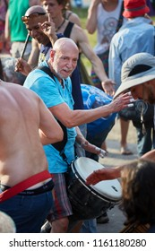 Montreal, Canada - June, 2018. Elder percussionist plays rhythm with djembe drum bongo in the middle of the crowd at Tam Tams festival in Mount Royal Park, Montreal, Canada. Editorial use.