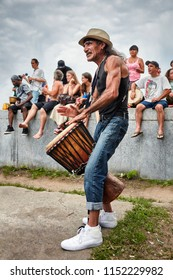 Montreal, Canada - June, 2018. Male Latino percussionist plays rhythm with bongo in front of the audience at Tam Tams festival in Mount Royal Park, Montreal, Quebec, Canada. Editorial use.