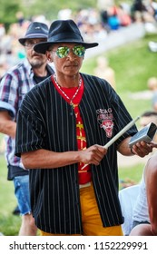 Montreal, Canada - June, 2018. Male Latino percussionist plays rhythm with a cow bell at Tam Tams festival in Mount Royal Park, Montreal, Quebec, Canada. Editorial use.