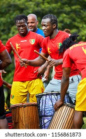 Montreal, Canada - June, 2018. Male African percussionists play djembe and dunun drums at Tam Tams festival in Mount Royal Park, Montreal, Quebec, Canada. Editorial use.