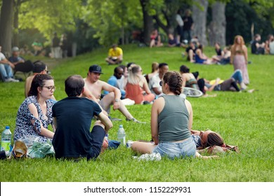 Montreal, Canada - June, 2018. Young people rest, relax and chat on the green grasses of Mount Royal park in Montreal, Quebec, Canada. Editorial use.