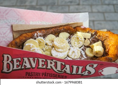 Montreal, Canada - june 2019 : view of a Beavertail with chocolate and banana, a typical canadian pastry