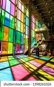 MONTREAL, CANADA - JUNE 22, 2010: The colourful glass panels facing the sunlight in Palais des congres de Montreal (Montreal Convention and Conference Centre)  located in Downtown Montreal, Canada