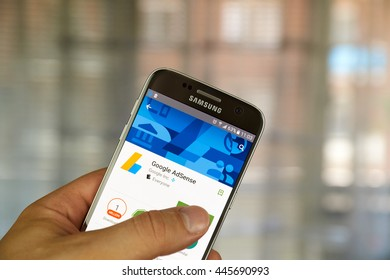 MONTREAL, CANADA - JUNE 23, 2016 : Google Adsense app on Samsung S7 screen. AdSense is a program that allows publishers in the Google Network of content sites to serve automatic advertisements