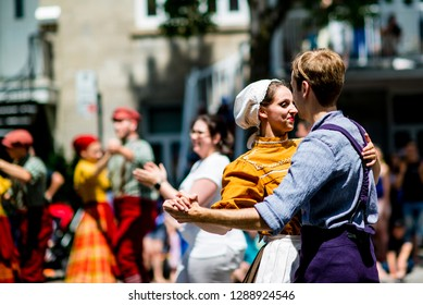 Montreal, Canada - June 24 2017: People with 19th century costume dancing in the Quebec Day Parade in Montreal downtown