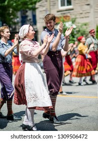 Montreal, Canada - June 24 2017: People wearing 19th century costume celebrating in the Quebec Day Parade in Montreal downtown