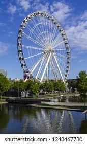 MONTREAL, CANADA June 25, 2018: La Grande Roue de Montreal is the tallest Ferris wheel in Canada. The Big Ferris Wheel in Old Harbour.