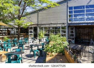 Montreal, Canada - June 25, 2018: The outside of Bars and Restaurants near the Old Port of Montreal during the day.