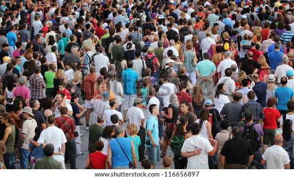 MONTREAL, CANADA - JUNE 29: People walk during the open-air concert at the 33th International Jazz Festival of Montreal on June 29, 2012 in Montreal, Canada