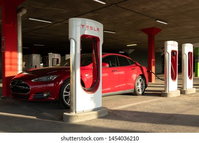 MONTREAL, CANADA - June 9, 2019: Tesla Model S at Tesla Supercharger in Montreal, Quebec at the Place Vertu Shopping Centre.